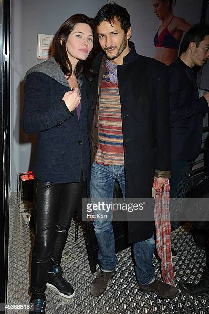 Actors Delphine Chaneac and Kamel Belghazi attend The 'Reebok Concept Store' Opening Party at Avenue De L'Opera on December 4 2013 in Paris France