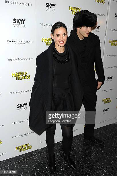 Actors Demi Moore and Ashton Kutcher attend a screening of Happy Tears hosted by the Cinema Society and Donna Karan at The Museum of Modern Art on...
