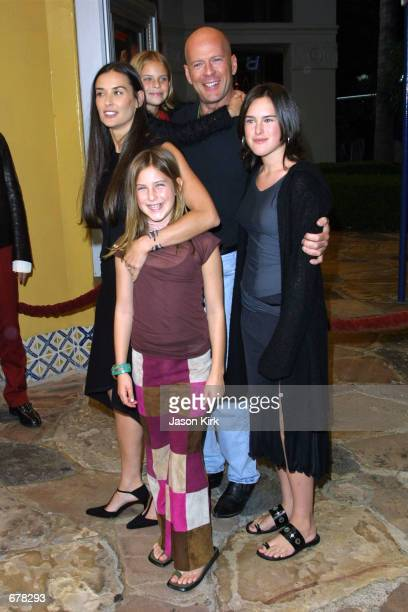 Actors Demi Moore and Bruce Willis with their daughters Rumer and Scout arrive at the premiere of the film Bandits October 4 2001 in Westwood CA