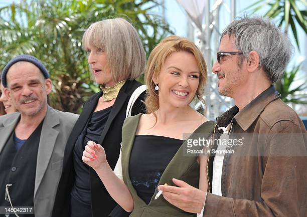 Actors Denis Lavant Edith Scob Kylie Minogue and director Leos Carax pose at the Holy Motors photocall during the 65th Annual Cannes Film Festival at...