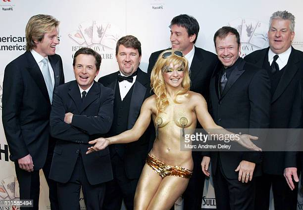 Actors Denis Leary Michael J Fox poker player Chris Moneymaker former NHL Boston Bruin Cam Neely Donnie Wahlberg and Lenny Clarke with 'Glitter Girl'...