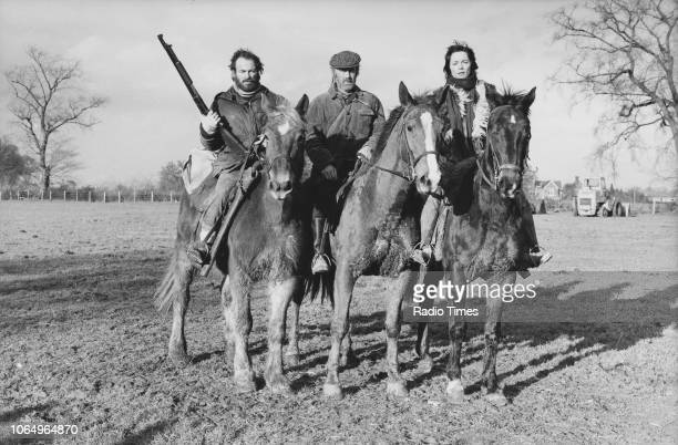 Actors Dennis Lill John Albineri and Lucy Fleming on horseback in a scene from episode 'Manhunt' of the television series 'Survivors' February 19th...