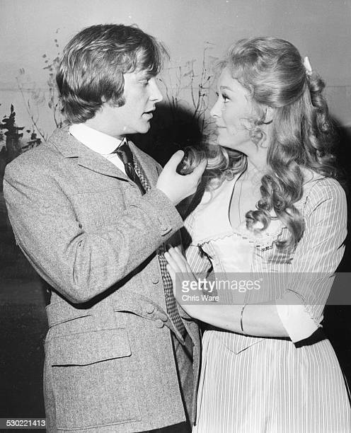 Actors Dennis Waterman and Jenny Hailey smiling together at an event circa 1970