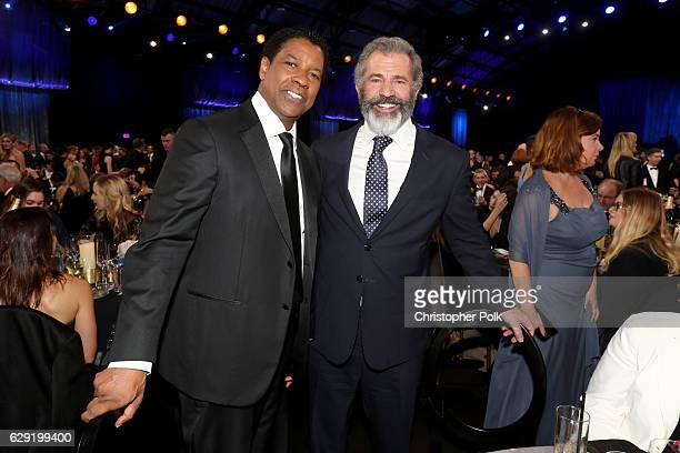 Actors Denzel Washington and Mel Gibson attend The 22nd Annual Critics' Choice Awards at Barker Hangar on December 11 2016 in Santa Monica California