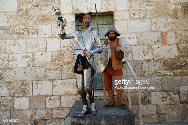 Actors depicting Don Quijote de la Mancha and Sancho Panza perform in the street during the Cervante's Week on October 7 2016 in Alcala de Henares...