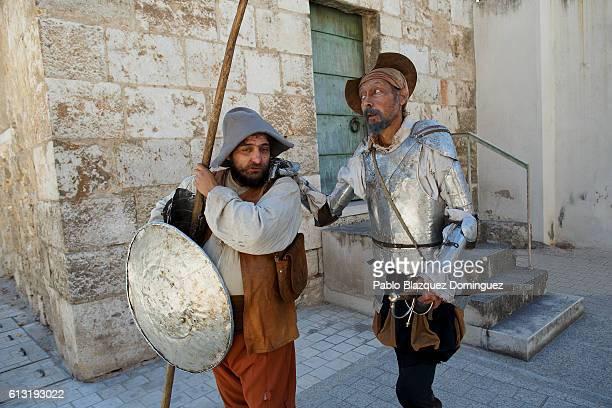 Actors depicting Don Quijote de la Mancha and Sancho Panza perform in the street during the Cervante's Week on October 7 2016 in Alcala de Henares...