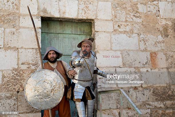 Actors depicting Don Quijote de la Mancha and Sancho Panza perform for photographers during the Cervante's Week on October 7 2016 in Alcala de...