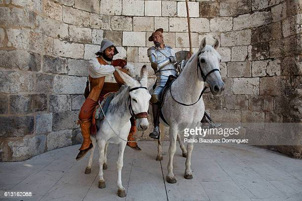 Actors depicting Don Quijote de la Mancha and Sancho Panza pose for photographers as the ride a horse and a donkey during the Cervante's Week on...