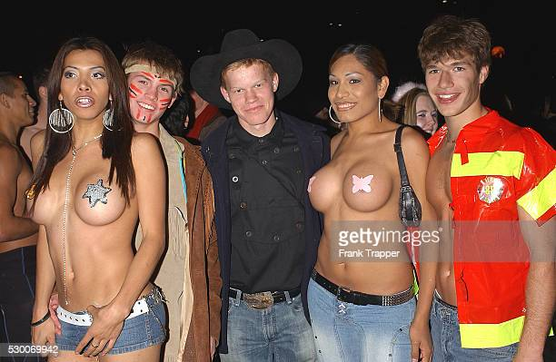 Actors Derek Ebner Jesse Plemmons and Michael Hammond with sexy girls in minimalist costume at the West Hollywood Halloween Carnival