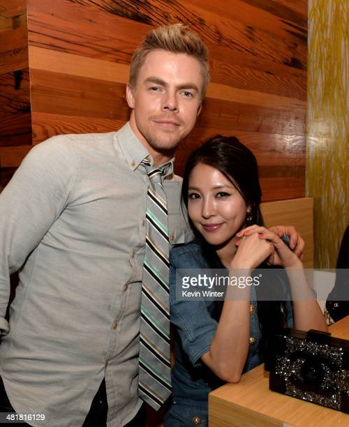 Actors Derek Hough and BoA pose at the after party for the screening of 'Make Your Move' at Umami Burger on March 31 2014 in Los Angeles California