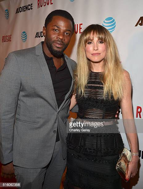 Actors Derek Luke and Sarah Carter attend the party celebrating The ATT's 'ROGUE' at the London Hotel on March 16 2016 in Los Angeles California