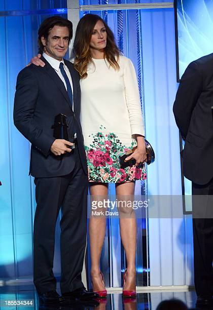 Actors Dermot Mulroney and Julia Roberts onstage during the 17th annual Hollywood Film Awards at The Beverly Hilton Hotel on October 21 2013 in...