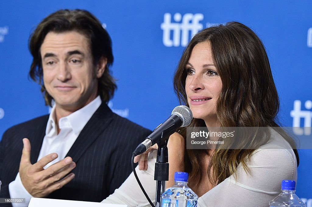 Actors Dermot Mulroney and Julia Roberts speak at the 'August: Osage County' Press Conference during the 2013 Toronto International Film Festival at TIFF Bell Lightbox on September 10, 2013 in Toronto, Canada.