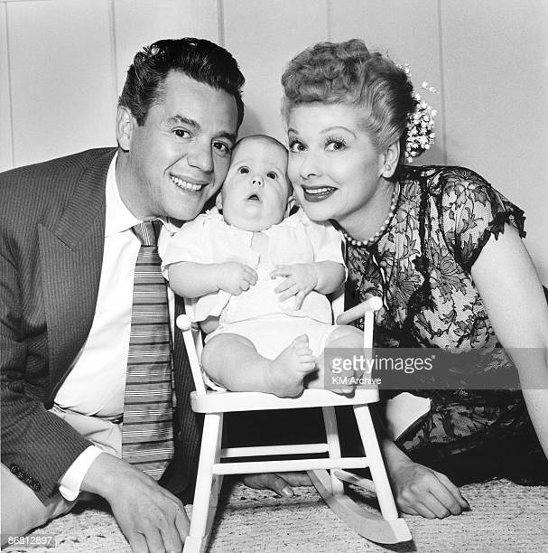 Actors Desi Arnaz and Lucille Ball pose with their son Desi Arnaz Jr at their home in California January 1953