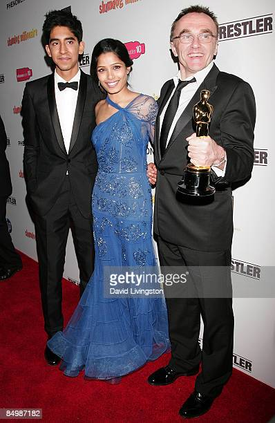 Actors Dev Patel and Freida Pinto and director Danny Boyle with his Academy Award for Best Director attend the Fox Searchlight official Slumdog...