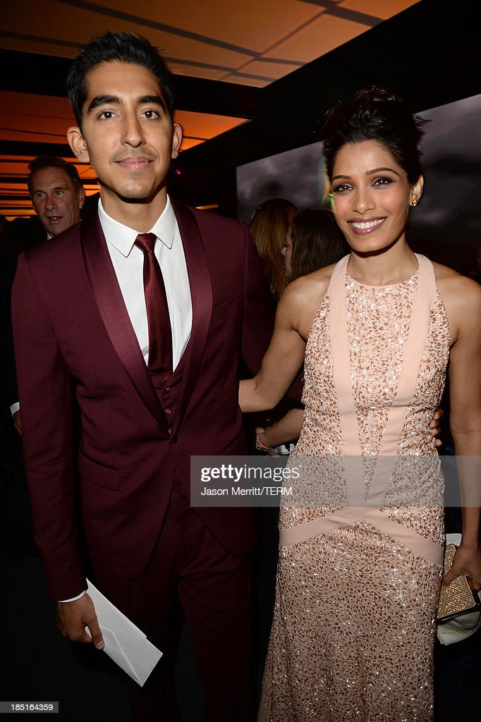 Actors Dev Patel (L) and Freida Pinto, wearing Ferragamo, attend the Wallis Annenberg Center for the Performing Arts Inaugural Gala presented by Salvatore Ferragamo at the Wallis Annenberg Center for the Performing Arts on October 17, 2013 in Beverly Hills, California.