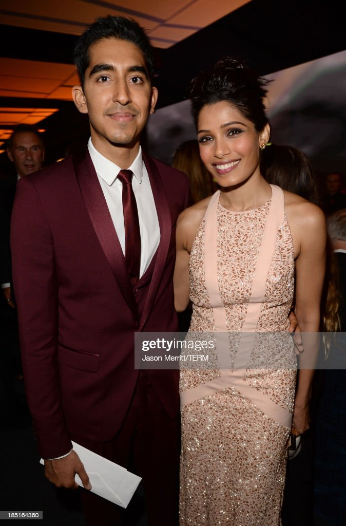 Actors Dev Patel, (L) and Freida Pinto, wearing Ferragamo, attend the Wallis Annenberg Center for the Performing Arts Inaugural Gala presented by Salvatore Ferragamo at the Wallis Annenberg Center for the Performing Arts on October 17, 2013 in Beverly Hills, California.