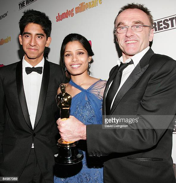 Actors Dev Patel Freida Pinto and director Danny Boyle with his Academy Award for Best Director attend the Fox Searchlight official Slumdog...