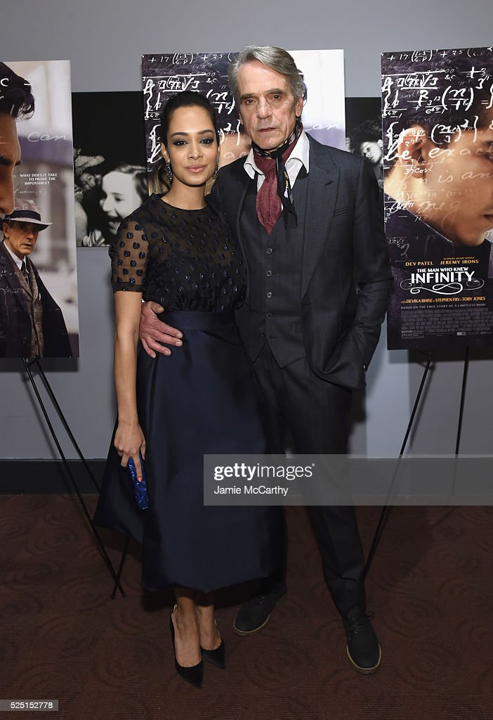 Actors Devika Bhise (L) and Jeremy Irons attend 'The Man Who Knew Infinity' New York screening at Chelsea Bow Tie Cinemas on April 27, 2016 in New York City.