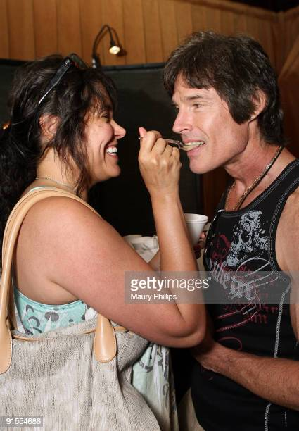 Actors Devin Devasquez and Ronn Moss pose in the Daytime Emmy official gift lounge produced by On 3 Productions held at The Orpheum Theatre on August...