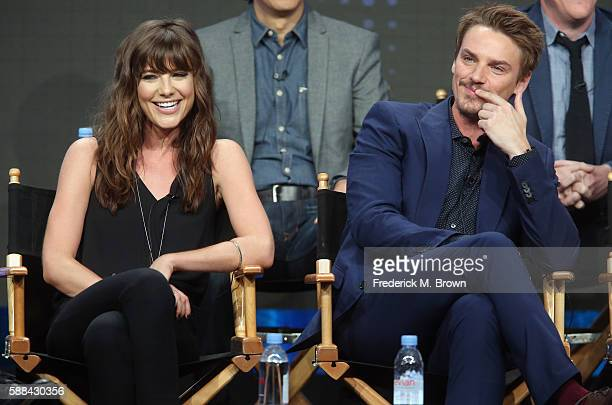Actors Devin Kelley and Riley Smith speak onstage at the 'Frequency' panel discussion during The CW portion of the 2016 Television Critics...