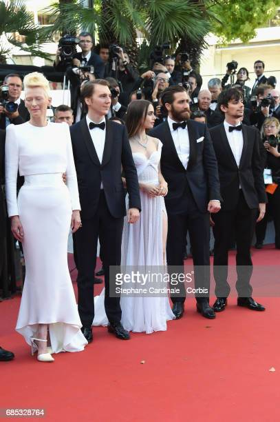 Actors Devon Bostic Jake Gyllenhaal Lily Collins Paul Dano and Tilda Swinton attend the Okja premiere during the 70th annual Cannes Film Festival at...