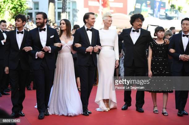 Actors Devon Bostic Jake Gyllenhaal Lily Collins Paul Dano Tilda Swinton director Bong JoonHo actors Ahn SeoHyun and Steven Yeun attend the 'Okja'...