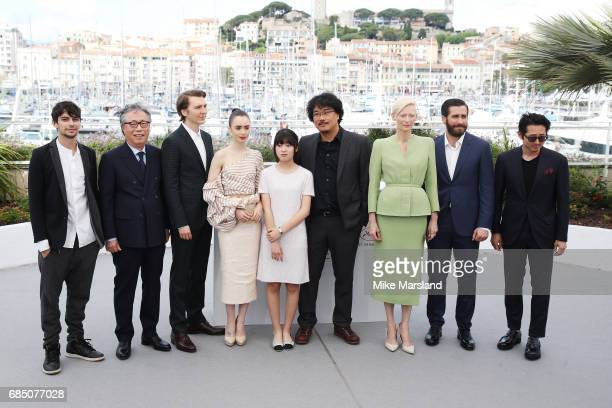 Actors Devon Bostick Byung Heebong Paul Dano Lily Collins Ahn SeoHyun director Bong JoonHo Tilda Swinton Jake Gyllenhaal and Steven Yeun attend the...