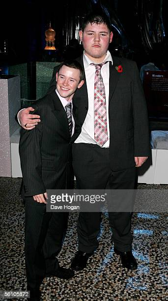 """Actors Devon Murray and Jamie Waylett attend the party for the World Premiere of """"Harry Potter And The Goblet Of Fire"""" at The Natural History Museum..."""