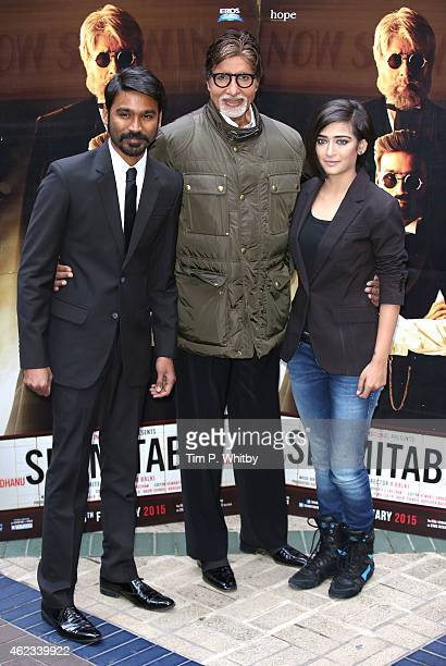 Actors Dhanush Amitabh Bachchan and Akshara Haasan attend a photocall for 'Shamitabh' at St James Court Hotel on January 27 2015 in London England