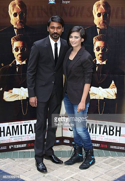 Actors Dhanush and Akshara Haasan attend a photocall for 'Shamitabh' at St James Court Hotel on January 27 2015 in London England