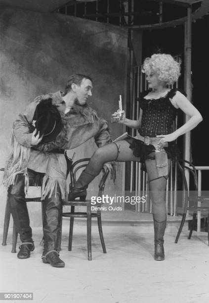 Actors Diane Cilento as Rosario and Michael Deacon as Franklin Muldoon in a scene from the play 'The Artful Widow' by Carlo Goldoni during dress...