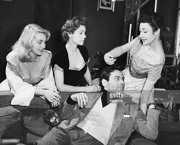Actors Diane Cilento Rene Asherson Sam Wanamaker and Heather Stannard rehearsing a scene for the play 'The Big Knife' London January 1st 1954