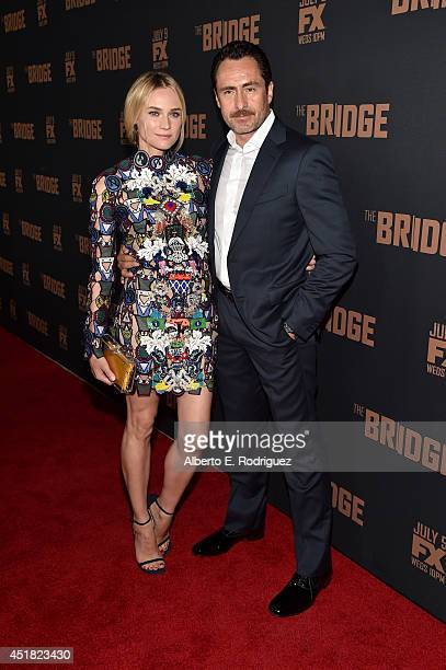 Actors Diane Kruger and Demian Bichir attend the premiere of FX's 'The Bridge' at Pacific Design Center on July 7 2014 in West Hollywood California