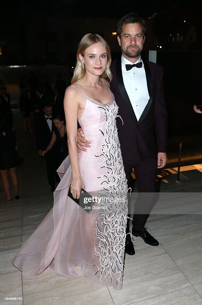 Actors Diane Kruger (L) and Joshua Jackson for FIJI Water At amfAR's Inspiration Gala Los Angeles at Milk Studios on October 29, 2015 in Hollywood, California.