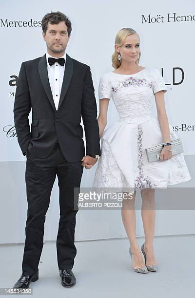 Actors Diane Kruger and Joshua Jackson pose as they arrive to attend the 2012 amfAR's Cinema Against Aids on May 24, 2012 in Antibes, southeastern...