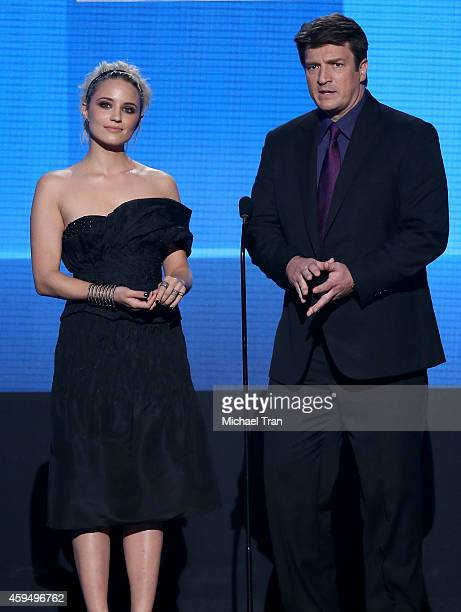 Actors Dianna Agron and Nathan Fillion speak onstage during the 2014 American Music Awards held at Nokia Theatre LA Live on November 23 2014 in Los...