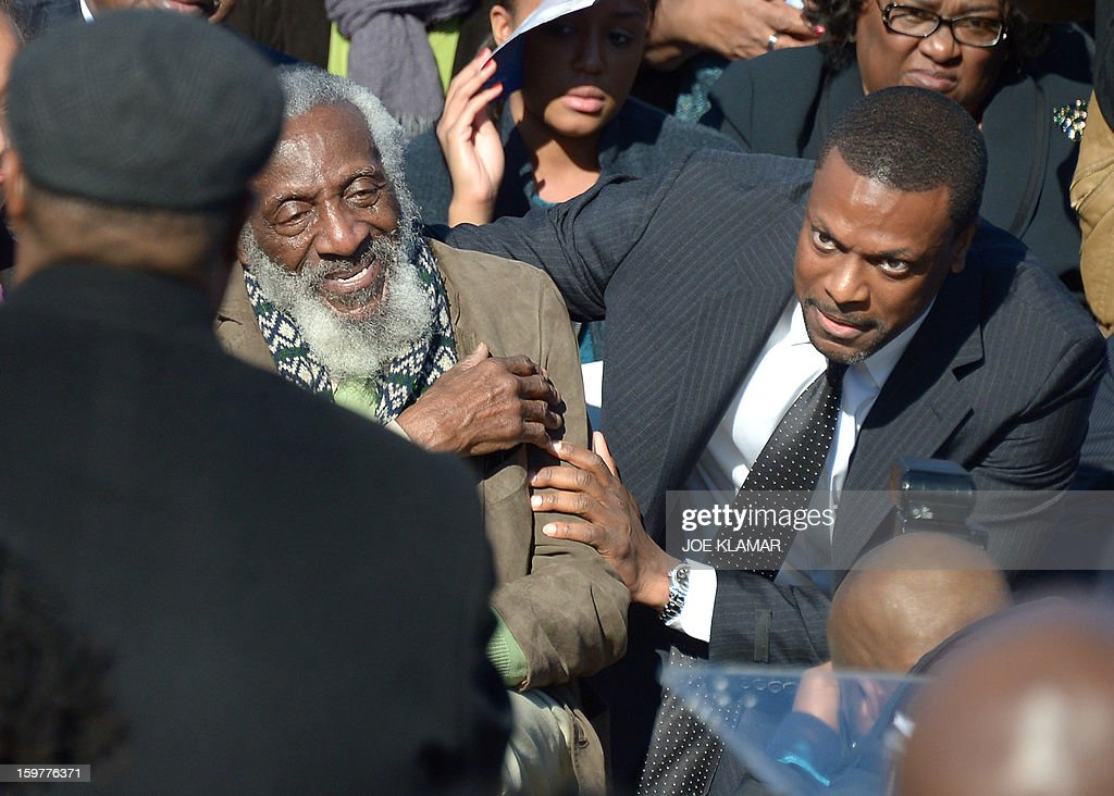 Actors Dick Gregory (L) and Chris Tucker attend Martin Luther King Day ceremony under the statue of civil rights leader Martin Luther King, Jr. at the MLK Memorial on January 20, 2013 in Washington. King is best known for his role in the advancement of civil rights using nonviolent civil disobedience.