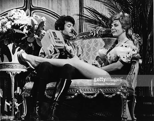 Actors Dick Shawn and Renee Taylor act on stage in their roles as Hitler and Eva Braun in a still from the film, 'The Producers,' directed by Mel...