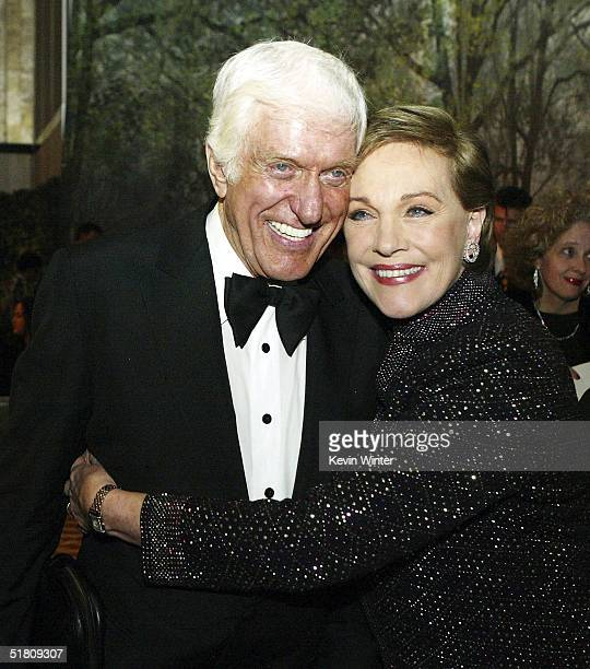 Actors Dick Van Dyke and Julie Andrews pose at the afterparty for Disney's 'Mary Poppins' 40th Anniversary Edition DVD Launch party and screening at...