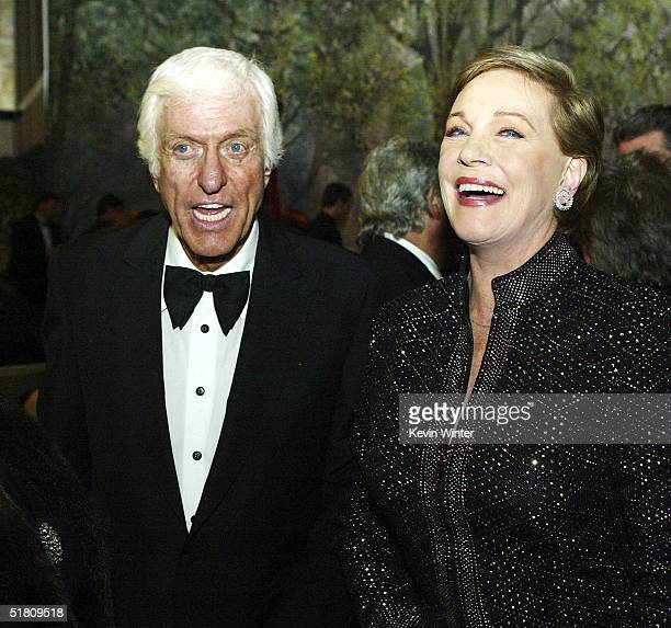 Actors Dick Van Dyke and Julie Andrews talk at the afterparty for Disney's Mary Poppins 40th Anniversary Edition DVD Launch party and screening at...