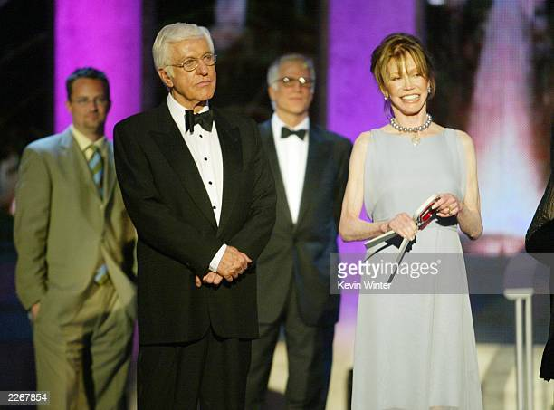 Actors Dick Van Dyke and Mary Tyler Moore from The Dick Van Dyke Show accept their Legend Award as actors Matthew Perry and Ted Danson look on during...