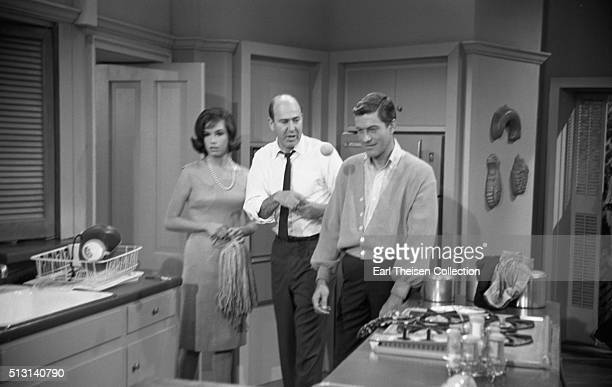 Actors Dick Van Dyke and Mary Tyler Moore with writer producer director and actor Carl Reiner in rehearsal for The Dick Van Dyke Show on December 2...