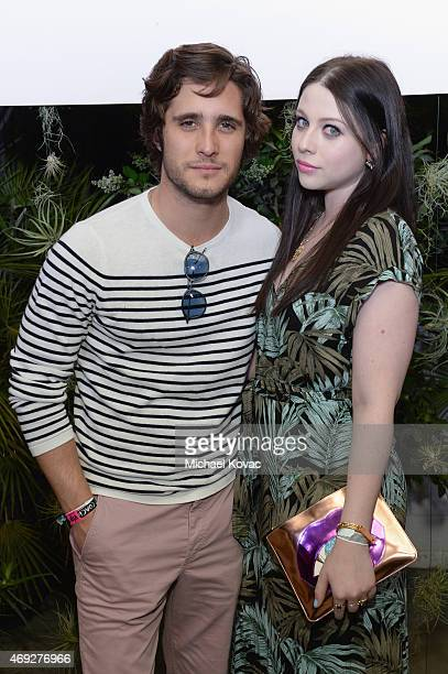 Actors Diego Boneta and Michelle Trachtenberg attend the Official HM Loves Coachella Party at the Parker Palm Springs on April 10 2015 in Palm...