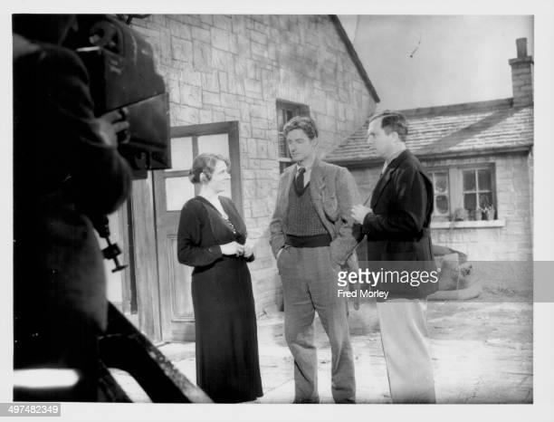 Actors Dilys Davies and Robert Donat with director King Vidor on the set of the film 'The Citadel' at Denham Studios June 24th 1938