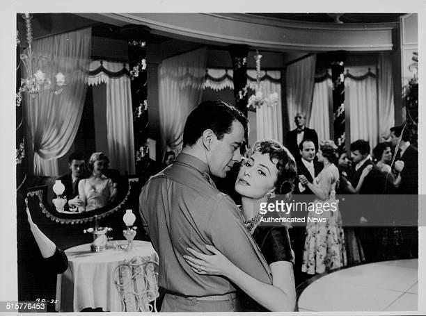Actors Dirk Bogarde and Olivia de Havilland dancing together, in a scene from the film 'Libel', 1959.