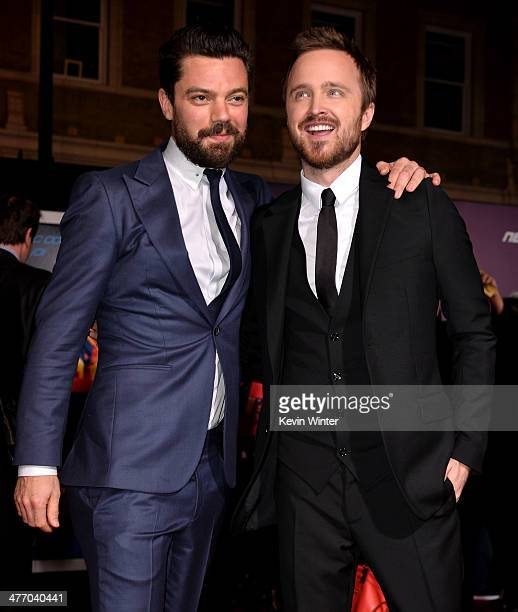 Actors Dominic Cooper and Aaron Paul arrive at the premiere of DreamWorks Pictures' 'Need For Speed' at TCL Chinese Theatre on March 6 2014 in...