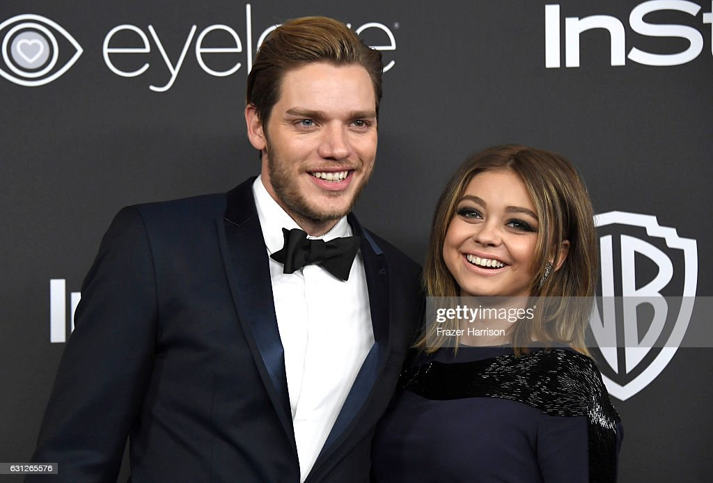 Actors Dominic Sherwood (L) and Sarah Hyland attend the 18th Annual Post-Golden Globes Party hosted by Warner Bros. Pictures and InStyle at The Beverly Hilton Hotel on January 8, 2017 in Beverly Hills, California.