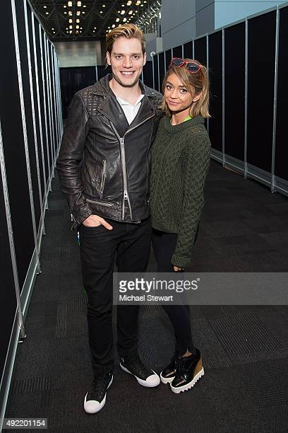 Actors Dominic Sherwood and Sarah Hyland pose in the press room for 'Shadowhunters' during New York ComicCon Day 3 at The Jacob K Javits Convention...