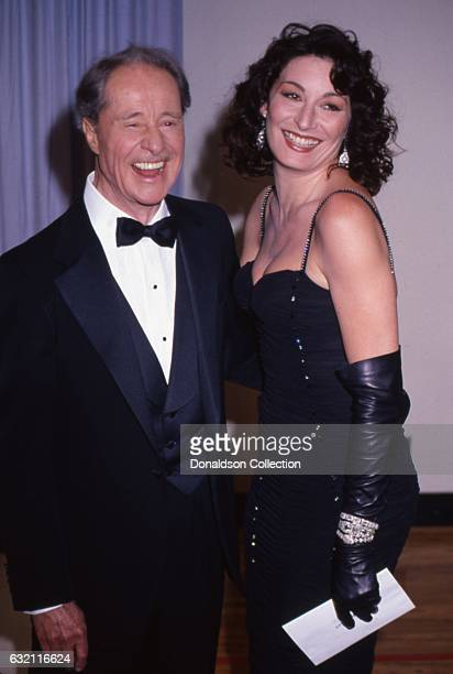 Actors Don Ameche and Anjelica Huston attends the Academy Awards in March 1987 in Los Angeles California